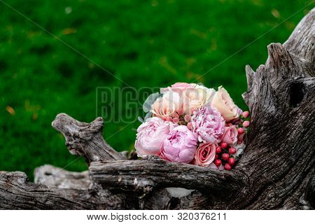 Nice And Beautiful Wedding Bouquet Of Flowers On Green Grass
