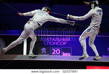 KIEV, UKRAINE - APRIL 14, 2012: Fight between Cody Mattern, USA, and Jean-Michel Lucenay, France, during final match of World Fencing Championship on April 14, 2012 in Kiev, Ukraine