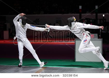 KIEV, UKRAINE - APRIL 14, 2012: Fight between Yannick Borel, France and Igor Tourchine, Russia during World Fencing Championship on April 14, 2012 in Kiev, Ukraine