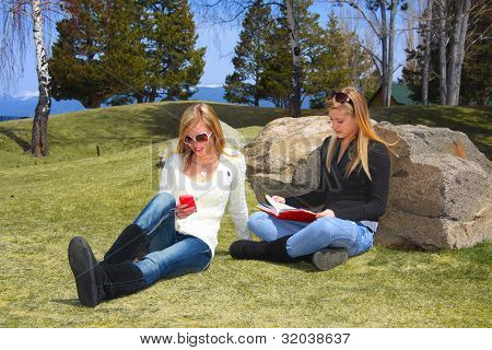 Teens Relaxing In Park