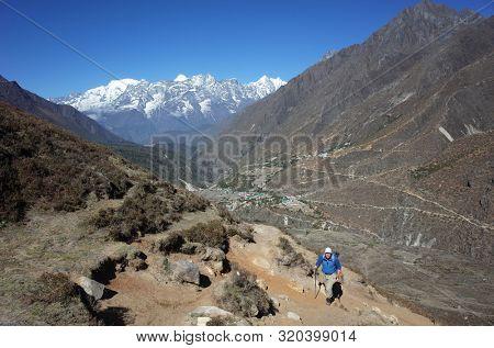 Trekker on the trail to Ama Dablam base camp - acclimatization day walk from Pangboche village, Everest trek, Sagarmatha national park, Solukhumbu, Nepal