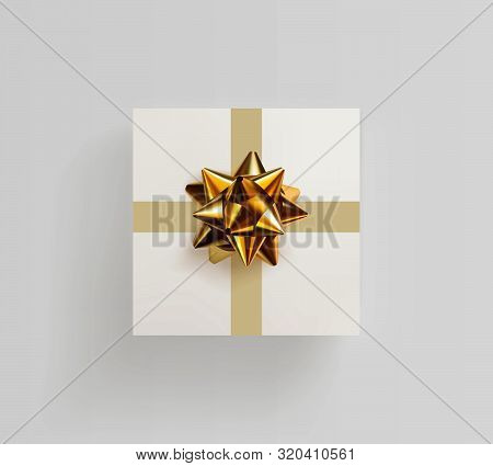 Decorative White Gift Box With A Realistic Golden Bow. Top View. Decoration For Greeting Cards, Invi