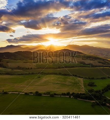 Dramatic Sunset Above Forests And Villages Of The Liptov Region In Slovakia With Great Fatra Mountai