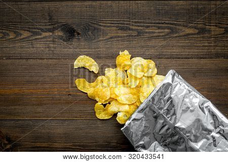 Potato Chips Bag Ready To Eat On Wooden Background Top View Mock Up