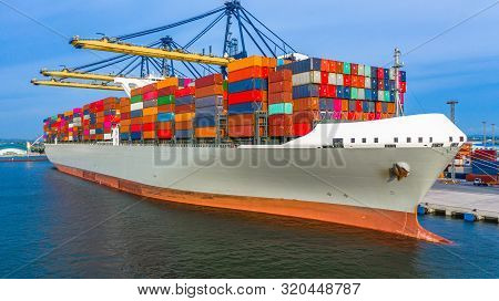Container Ship Loading And Unloading In Deep Sea Port, Aerial Top View Of Business Logistic Import A