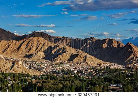 View of Leh from above from Shanti Stupa on sunset in Himalayas. Ladakh, Jammu and Kashmir, India