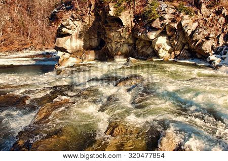 Picturesque Mountains River And Stones Rock. Carpathian Mountains.