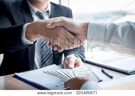 Dishonest Cheating In Business Illegal Money, Businessman Handshake With Money Of Dollar Banknotes I