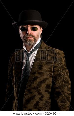 Middle aged man in vintage sunglasses pince nez and bowler