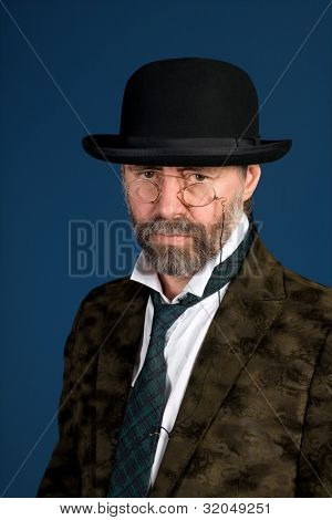 Middle-aged man in the vintage glasses pince nez.