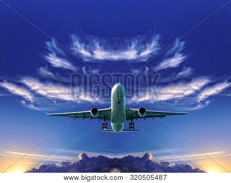 Commercial Airliner Flying Overhead In A Blue Sky With Vibrant White Cirrus Cloud.