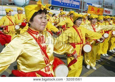 FLUSHING, NY - FEBRUARY 12: Falun Gong members stand as they participate in Chinese New Year celebrations February 12, 2005 in the Flushing neighborhood of New York City.