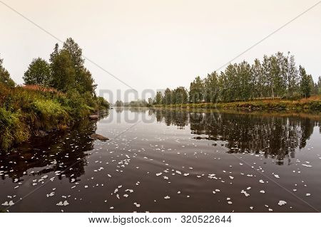 The Autumn Mist Has Risen On The Autumn Morning By The River At The Rural Finland. The River Water F