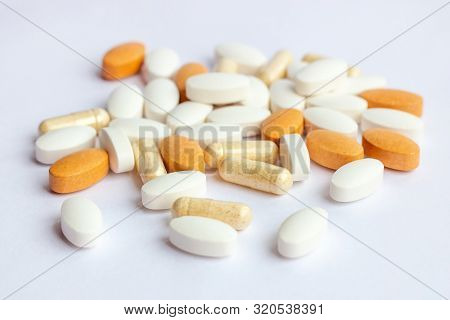 Many Different Pharmaceutical Medicine Pills, Tablets And Capsules On White Background. Pharmacy The