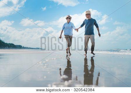 Asian Couple Senior Elder Retire Resting Relax Walking Running At Sunset Beach Honeymoon Family Toge