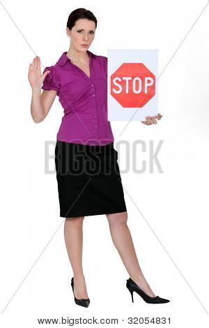 Smart woman with a stop sign