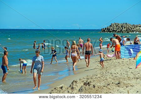 Wladislawowo / Poland. 24 June 2019: People Relax On Beach Of Baltic Sea During Summer Vacation. Bal