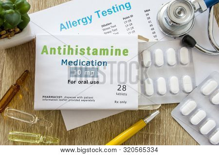 Antihistamine Medication Or Allergy Drug Concept Photo. On Doctor Table Is Pack With Word