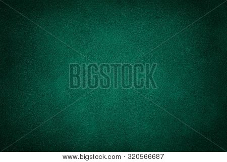 Dark Green Matte Background Of Suede Fabric, Closeup. Velvet Texture Of Seamless Deep Emerald Leathe