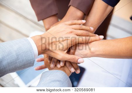 United Diverse Business Team Putting Their Hands Together. Closeup Of People Stacking Hands. Unity,