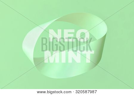 Mobius Strip Made From Paper Soaring In The Air On Mint Background. Trendy Surreal Airy Image. Abstr