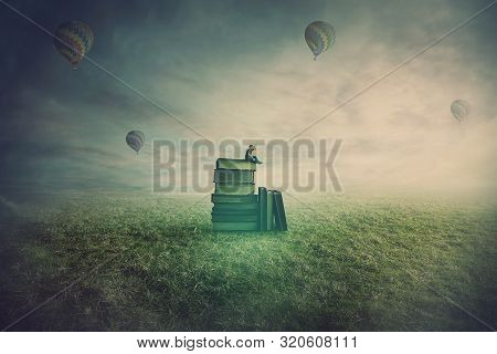 Surreal Scene As A Minuscule Man Seated On The Top Of A Books Pile In A Open Foggy Field, Holding Ha