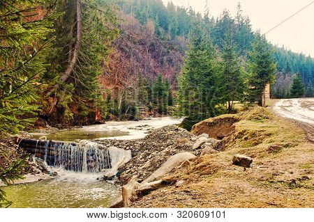 Spring Mountains River With River Dam And Stones Hill. Carpathian Mountains.