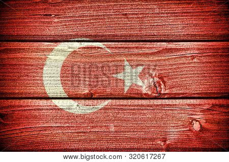Flag Of Turkey Painted On Old Grungy Wooden  Background