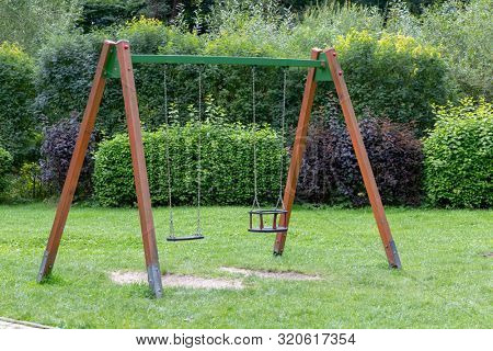 Double swing in playground in park