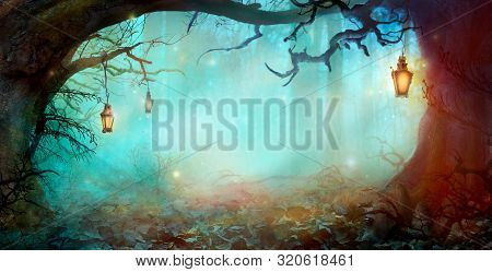 Halloween Background With Lanterns In Dark Forest In Spooky Night. Halloween Design In Magical Fores