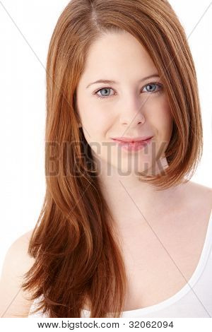 Portrait of gingerish teenage girl with long hair smiling.