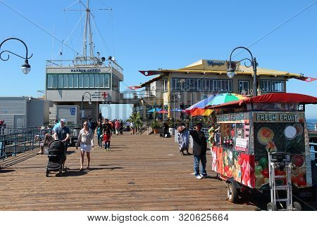 Santa Monica, United States - April 6, 2014: People Visit The Pier In Santa Monica, California. As O