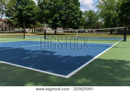 Recreational Sport Of Pickleball Court In Michigan, Usa Looking At An Empty Blue And Green New Court