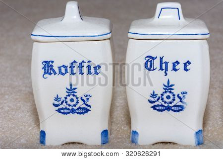 Delft Blue Coffee And Tea (koffie And Thee) Containers Close-up. Famous Porcelain Souvenirs From Hol