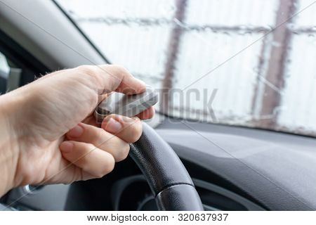 Woman Hand Inside The Car, Driver Using Remote Control To Open The Automatic Gate While Leaving Home