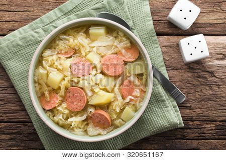 Fresh Homemade Cabbage, Potato And Sausage Stew In Bowl, Photographed Overhead (selective Focus, Foc