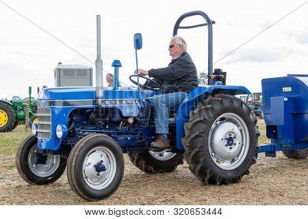 Haselbury Plucknett.somerset.united Kingdom.august 18th 2019.a Vintage Leyland Tractor Is Being Driv