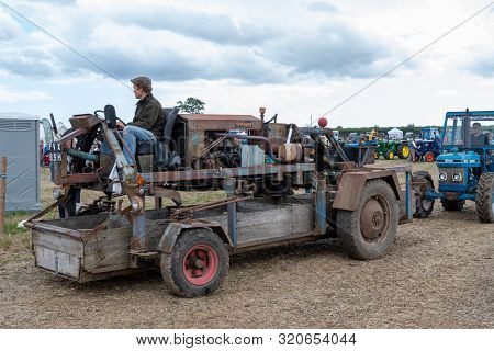 Haselbury Plucknett.somerset.united Kingdom.august 18th 2019.a Machine Used For Picking Up Boxes Of