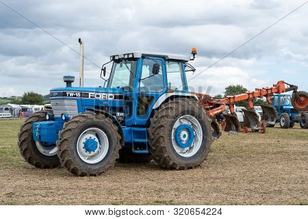 Haselbury Plucknett.somerset.united Kingdom.august 18th 2019.a Ford Tw15 Tractor Is Being Shown At A