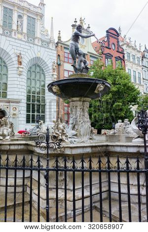 Gdansk, Poland - August 12, 2019: Famous Neptune's Fontain Located in Long Market (Dlugi Targ) Before Entering the Artus Court in Historical Old Town of Gdansk City, Pomeranian Voivodeship, Baltic Coa