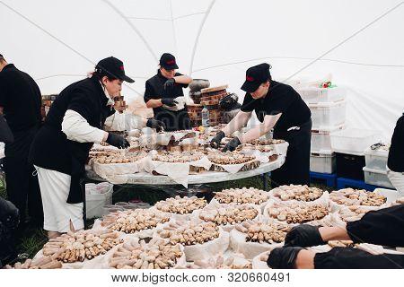 Belaris Minsk 26 07 2019 Workers Preparing Rolls For Catering.employees In Black Uniform Serving Aub
