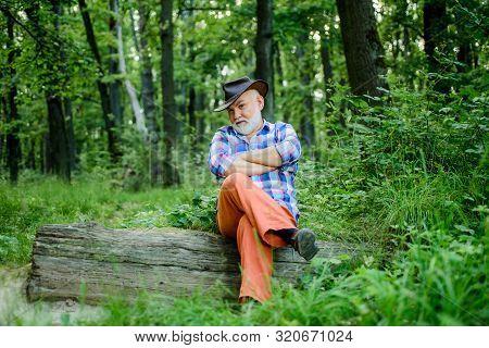 Freak Healer. Folk Magic. Mature Man With Beard In Hat. Wise Old Man. Herbal Remedies. Supernatural