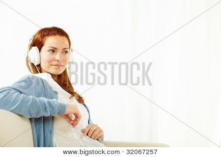 Elegant Woman Listening To Music