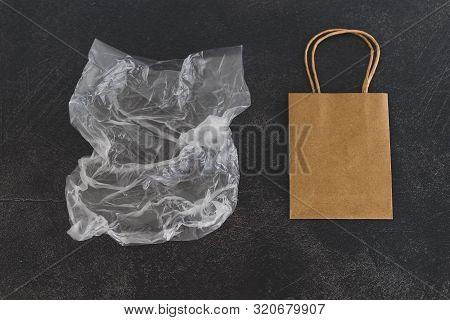 Sustainable Materials Still-life With Plastic Wrapping Vs Paper Bag