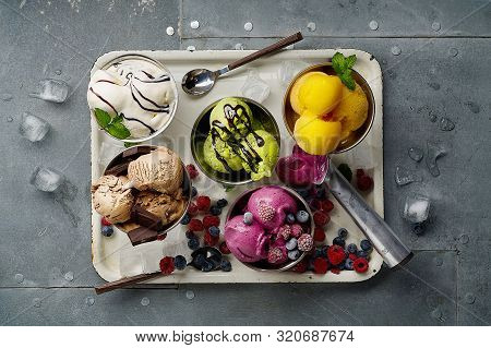 Assorted Flavors And Colors Of Gourmet Italian Ice Cream Served On Steel Table. Mango, Chocolate, Gr