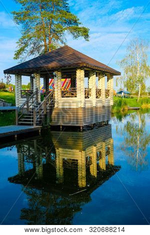 Moscow region, Russia - August, 28, 2019: alcove on a bank of the lake in Moscow region, Russia