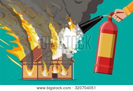Wooden House Burns Fire In Cottage. Extinguish Fire In Home. Fireman Hand With Fire Extinguisher. Or