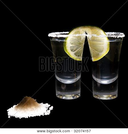 two shots of tequila with lime and salt