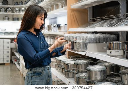 Asian Women Are Choosing To Buy New Kitchenware In The Mall. Shopping For Groceries And Housewares A