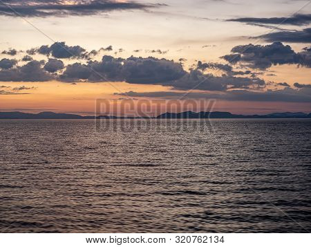 The Sun Sets Over Omura Bay In Nagasaki Prefecture, Japan As Seen From The Sasebo Seaside Line.